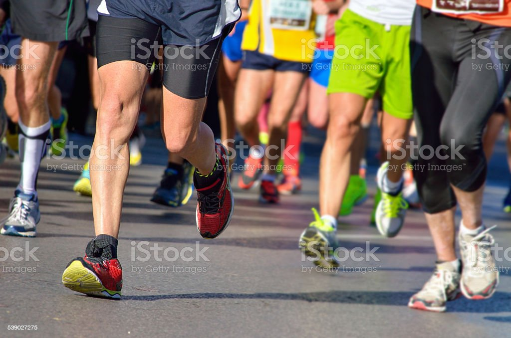 Marathon running race, people feet on road stock photo