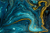 Marble abstract acrylic background. Blue marbling artwork texture. Agate ripple pattern. Gold powder.
