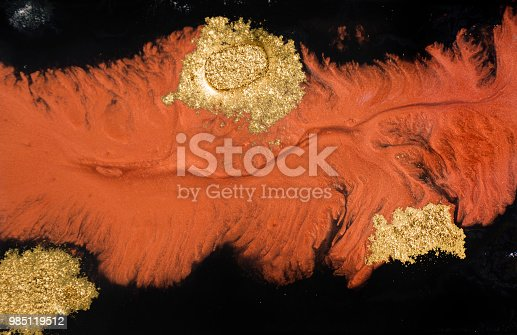 985119446istockphoto Marble abstract acrylic background. Marbling artwork texture. Agate ripple pattern. Gold powder. 985119512