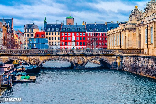 colorful houses, ancient bridge and river. Copenhagen, Denmark, Europe