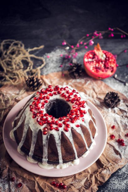 MArble cake with chocolate and pomegranates stock photo