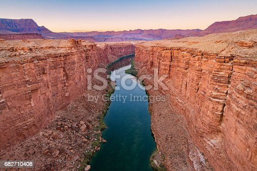 Landscape stock photograph of the Marble Canyon and the Colorado River as seen from the Navajo Bridge in Arizona USA just after sunset.