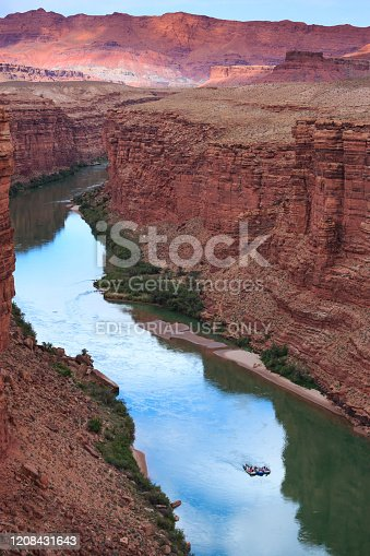 Lee's Ferry, AZ, USA - May 14, 2019: River rafters float through Marble Canyon at the beginning of their trip through the Grand Canyon.