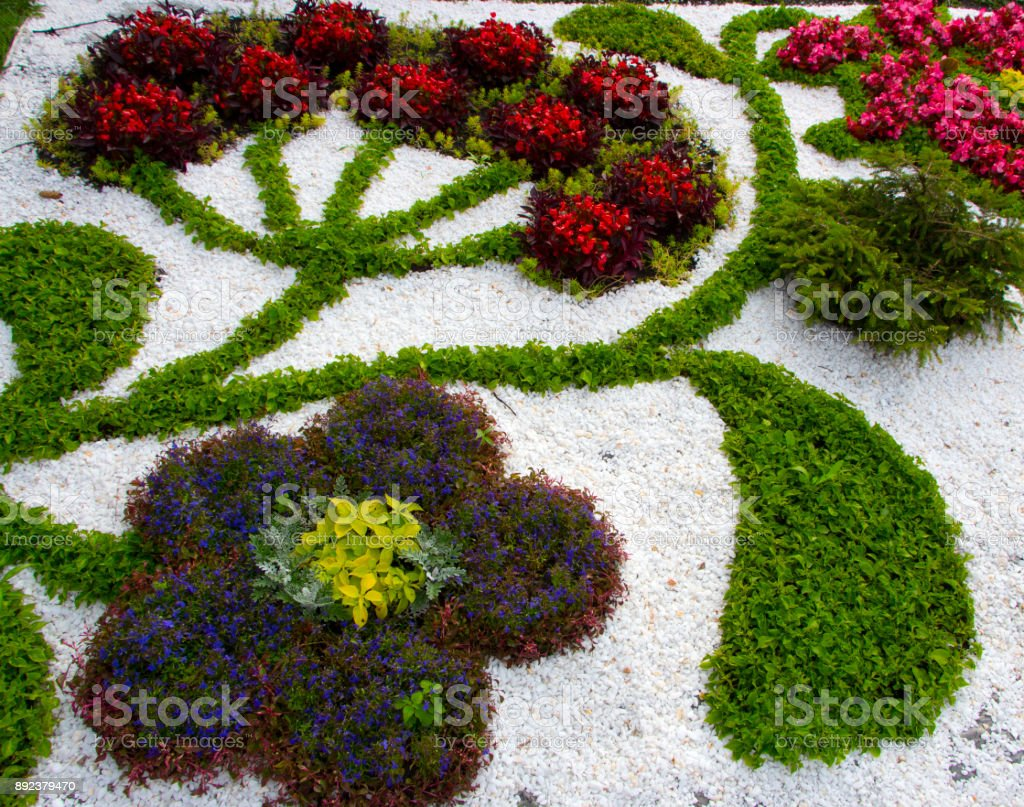 Marble chips and many annual flowers in rockeries stock photo