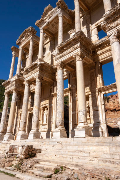 Marble Columns and statues, a clear blue sky, and fine stone carving highlight one of the most beautiful structures in all of Ephesus, the historic Library at Ephesus in Turkey.