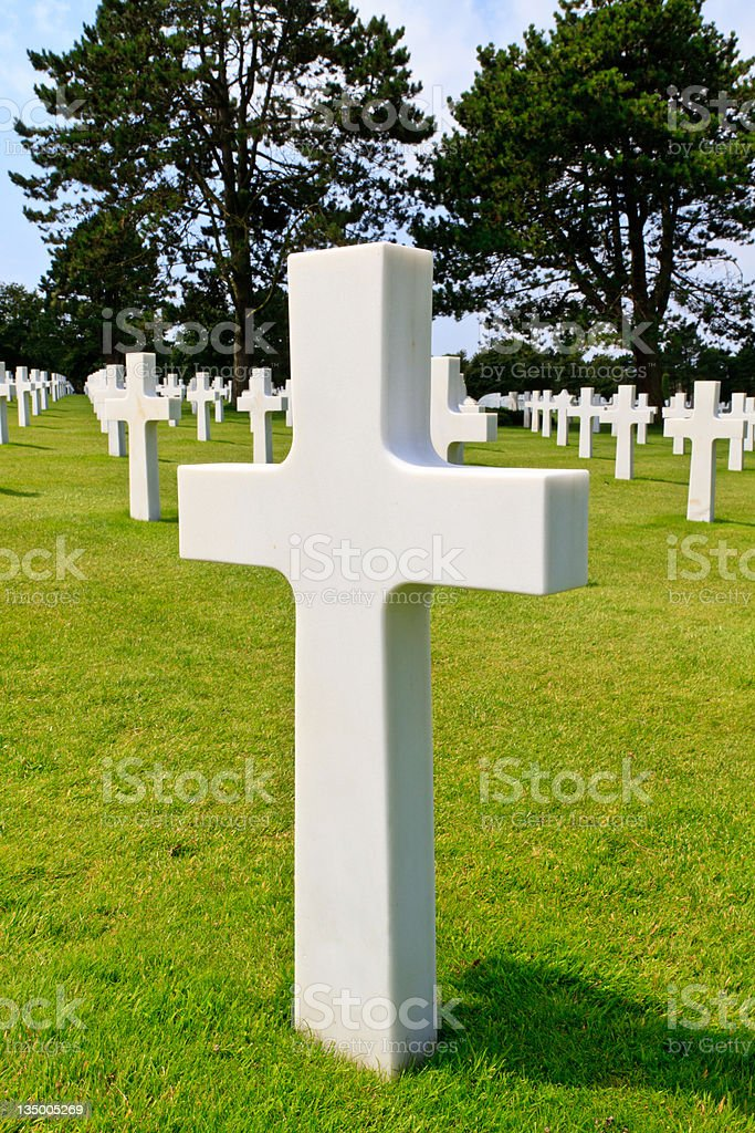 Marble Cross of fallen Soldier, American War Cemetery near Omaha royalty-free stock photo
