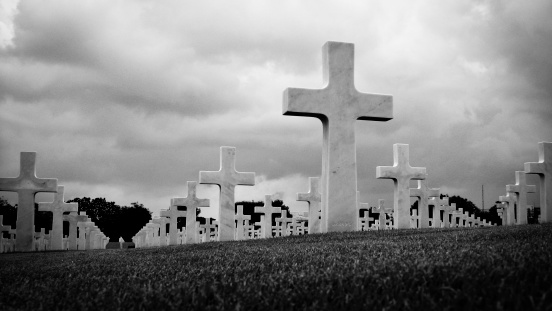 Marble Crosses on a Cemetery in Black and White