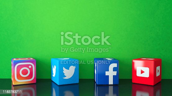 Istanbul, Turkey - October 26, 2019: Marble Cube shape of popular social media services icons, including Facebook, Instagram, Twitter, Youtube on black glass with green copy space
