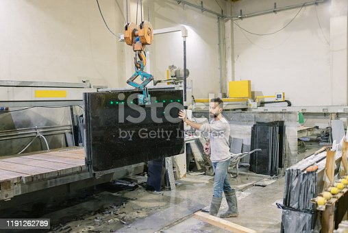 Marble factory worker  with crane