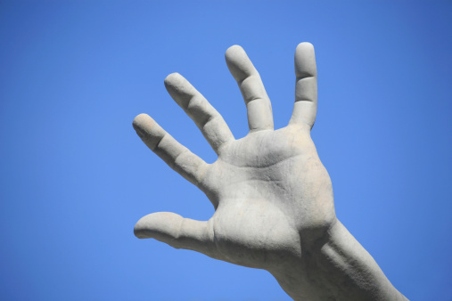 Marble hand against blue sky, Fountain of the Four Rivers by Bernini - Piazza Navona, Rome Italy