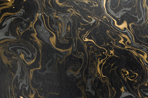 istock marble ink paper texture black grey gold 1091758300