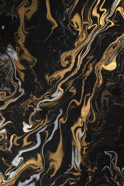 marble ink paper texture black silver gold stock photo