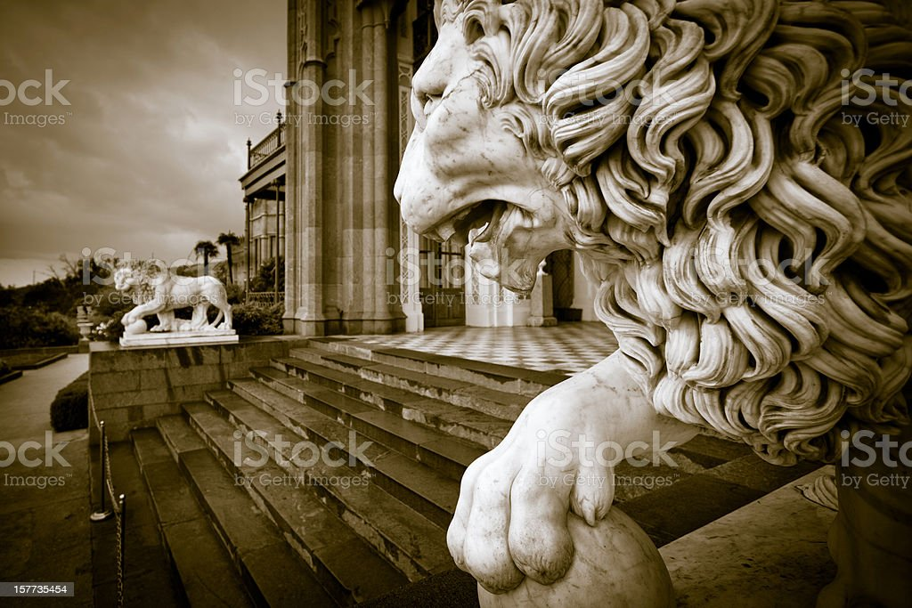 Marble lions guarding the entrance stock photo