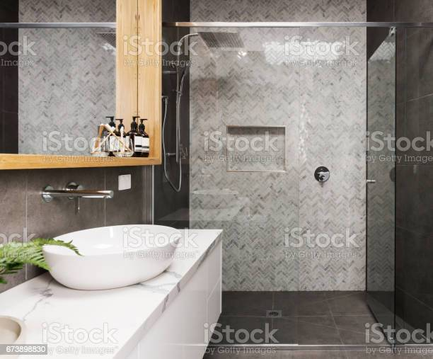 Marble Mosaic Herringbone Tiled Shower Feature Wall In A Contemporary Ensuite Bathroom Stock Photo - Download Image Now