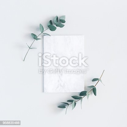 istock Marble paper blank, eucalyptus branches. Flat lay, top view, square 958835466