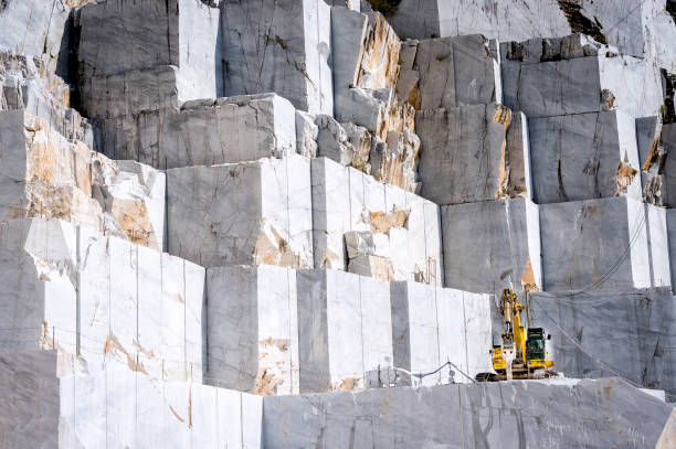 Marble quarry in Carrara, Tuscany, Italy The quarries are places where excavation and marble processing takes place for many centuries. quarry stock pictures, royalty-free photos & images