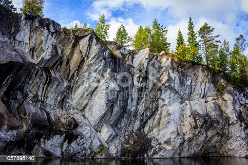 Marble quarry Ruskeala. Invalid marble quarry. Sights of Karelia in Russia. Quarry marble. Pieces and layers of marble.