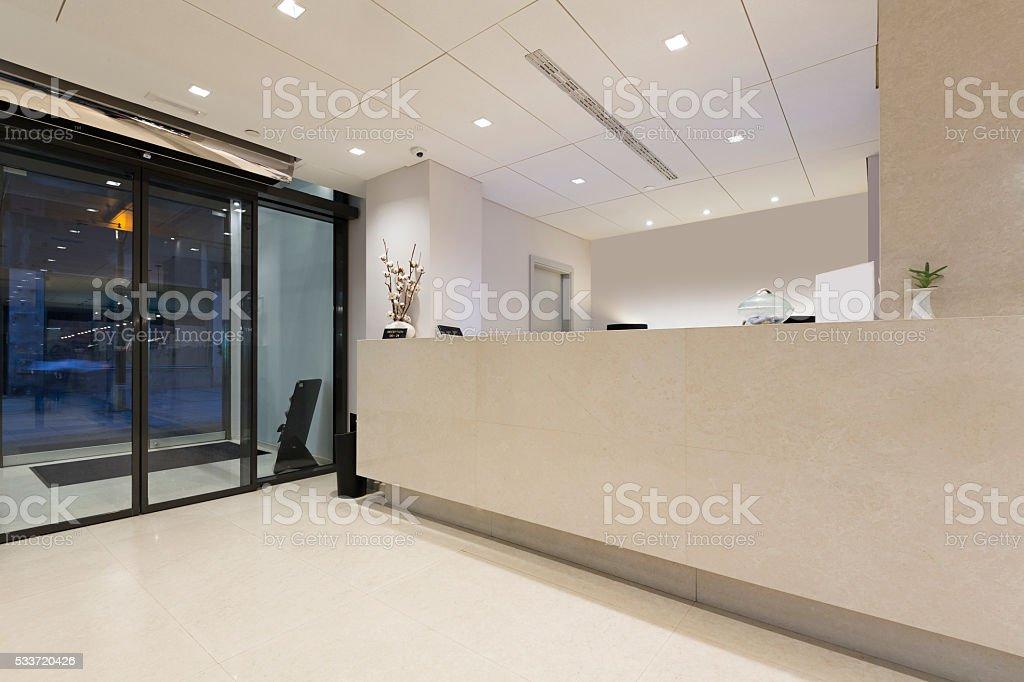 Marble reception desk in hotel stock photo
