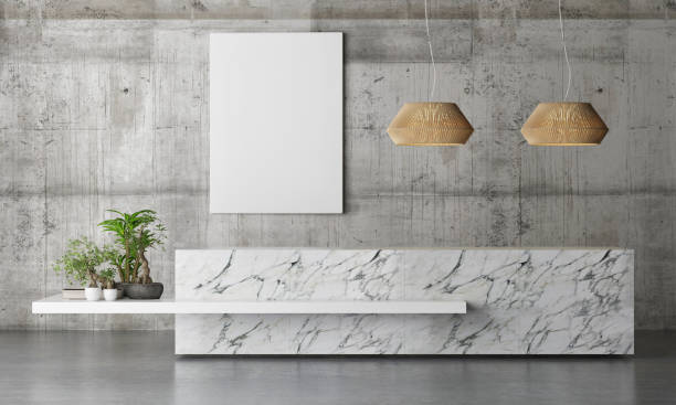 marble reception office table with plants on concrete background wall - lobby foto e immagini stock