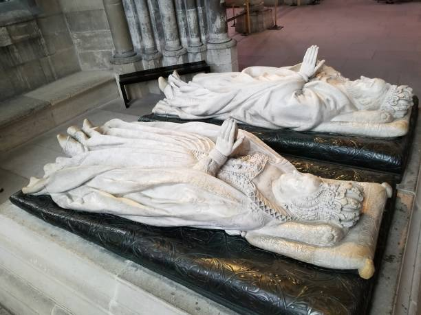 Marble recumbent effigies of Henry II and Catherine de' Medici in a chapel in the northern chevet in Basilica Cathedral of Saint-Denis stock photo