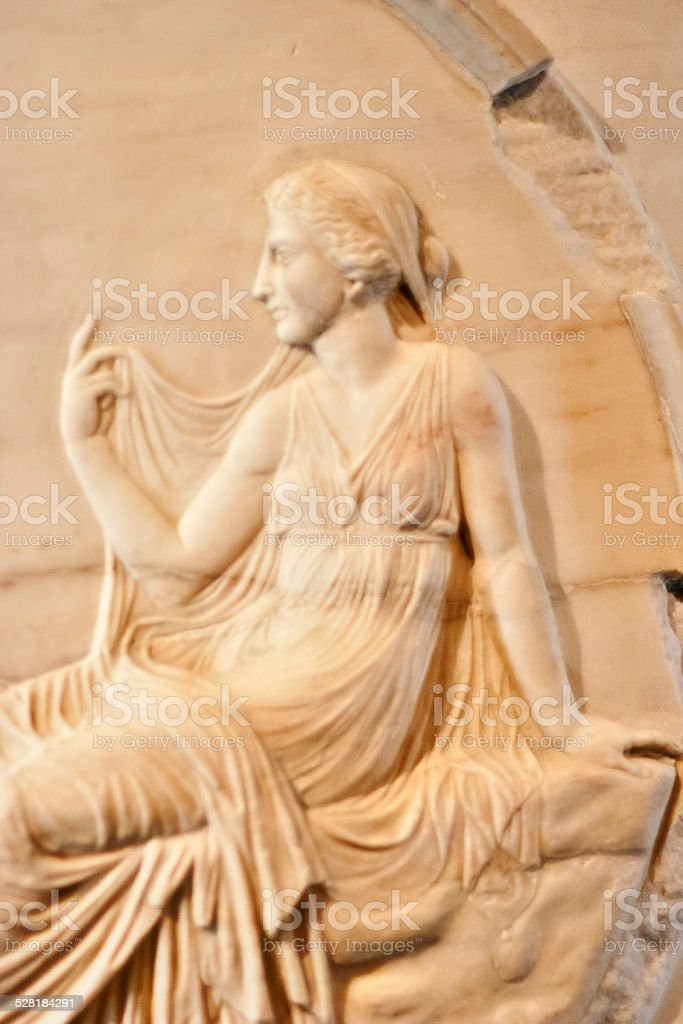 Marble relief of roman woman stock photo