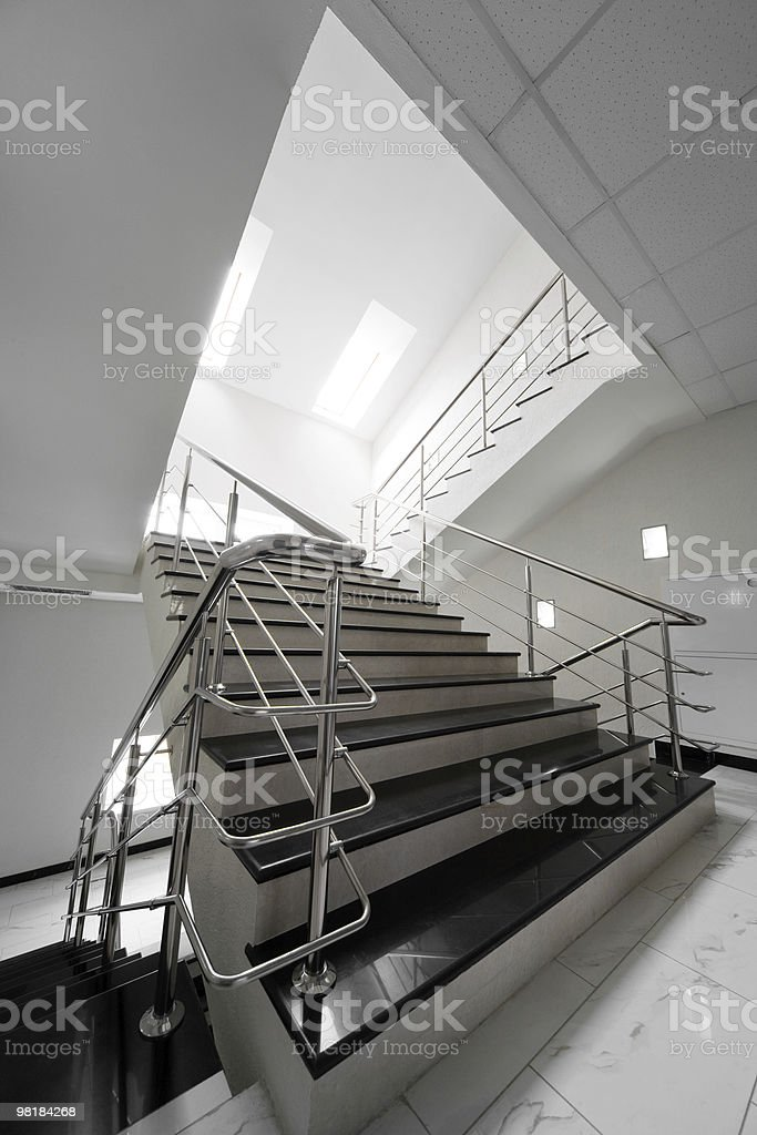 Marble staircase with a steel handrail royalty-free stock photo