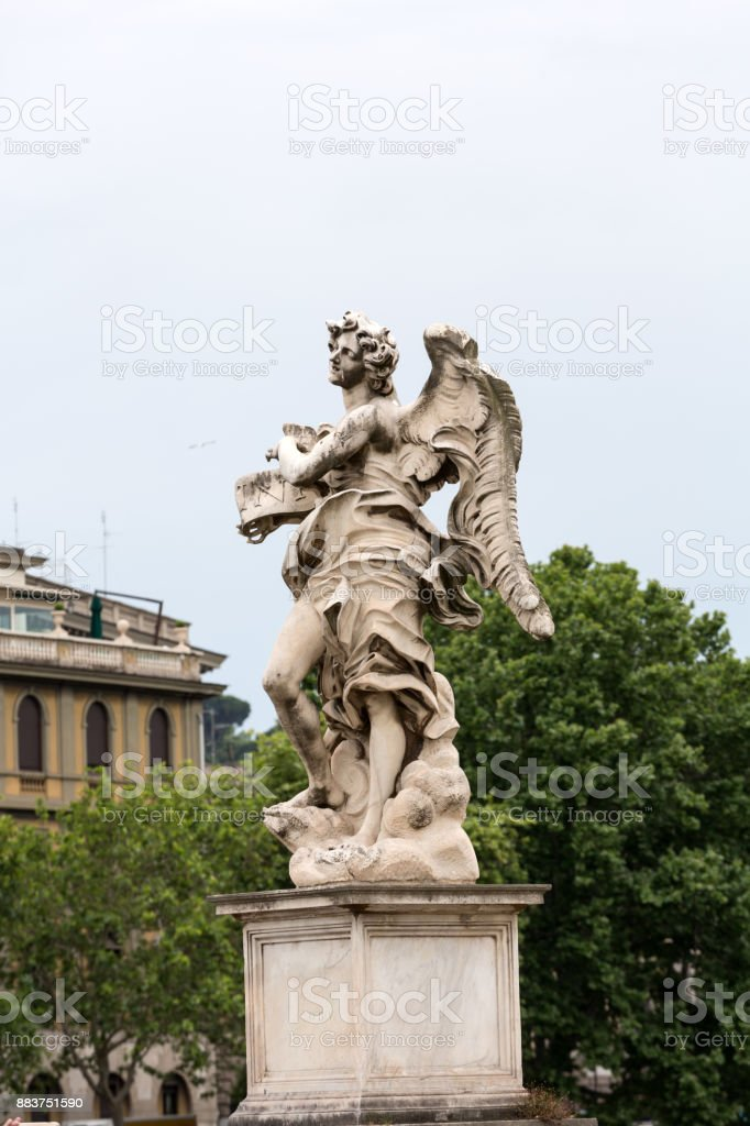 Marble statue of angel from the Sant'Angelo Bridge in Rome, Italy, designed by Bernini stock photo