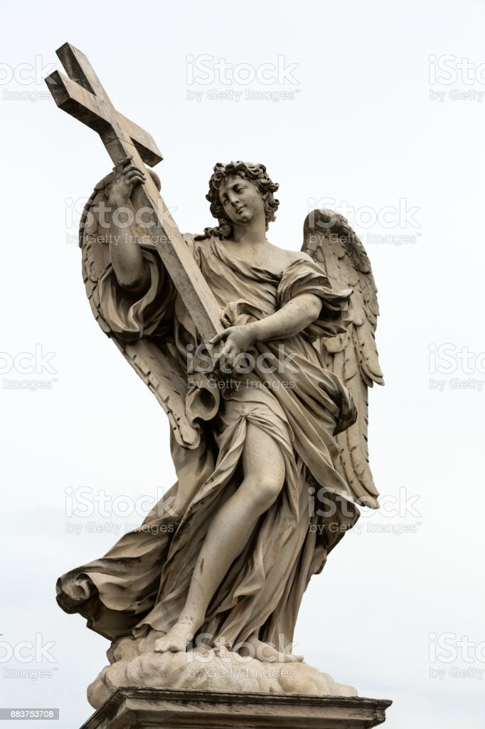 Marble statue of Angel with the Cross by Ercole Ferrata  from the Sant'Angelo Bridge in Rome, Italy stock photo