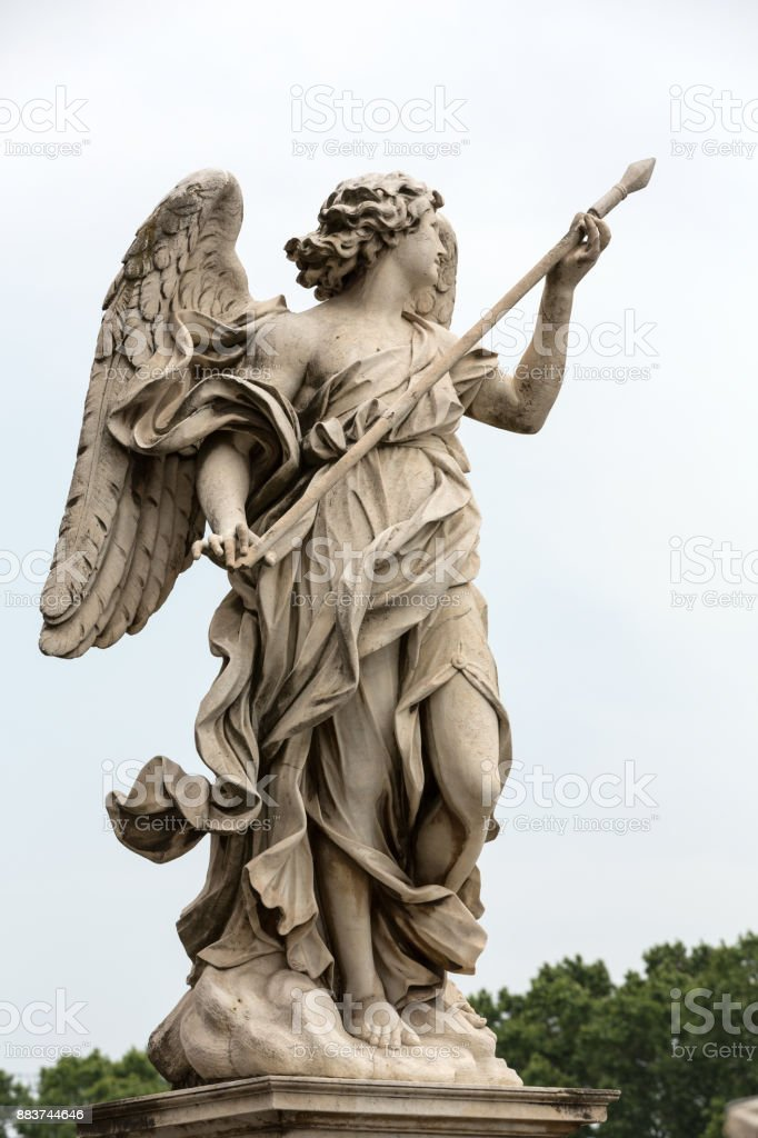 Marble statue of Angel with the Lance by Domenico Guidi from the Sant'Angelo Bridge in Rome, Italy stock photo