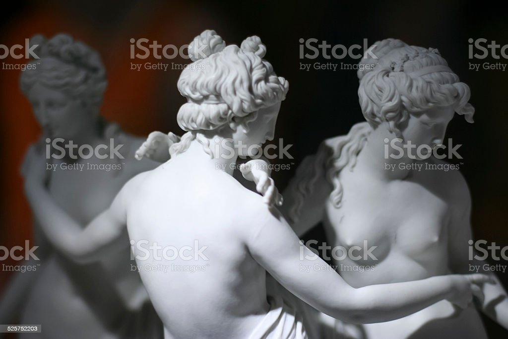 Marble statue of three naked women stock photo