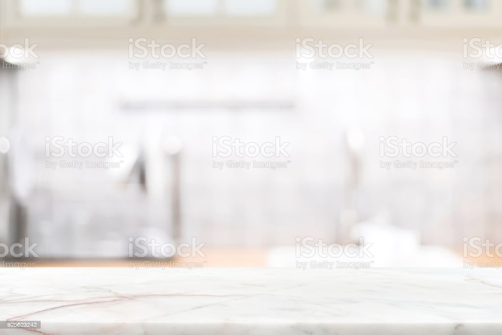 Marble stone countertop on blur kitchen interior background