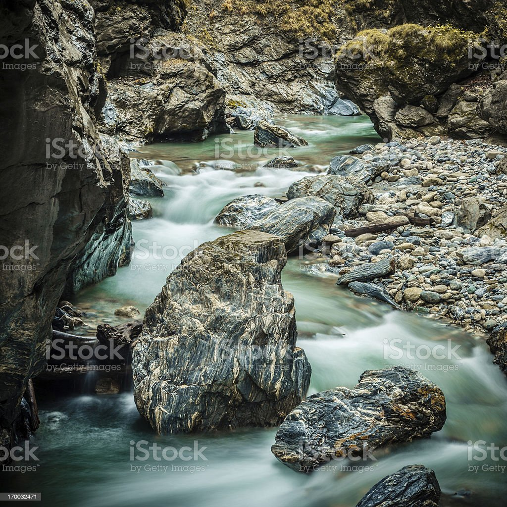 Marble stones in a mountain river royalty-free stock photo