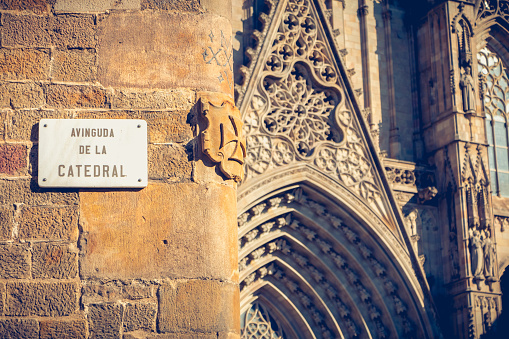 marble street sign where it is written in Spanish - Avenue of the cathedral