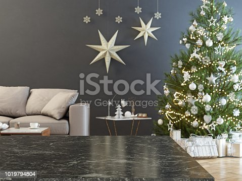 Marble table and blurred christmas tree background