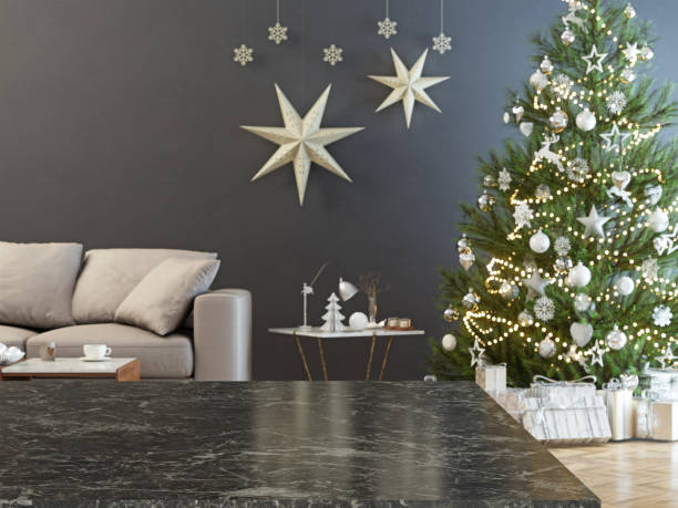 Marble table and blurred christmas tree background stock photo