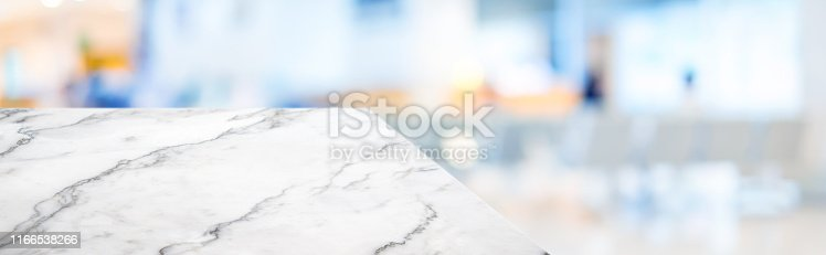 istock marble table top product display background with blur patient in hospital.left perspective stone kitchen counter with people waiting doctor in hallway.Banner mockup presentation for  health product 1166538266