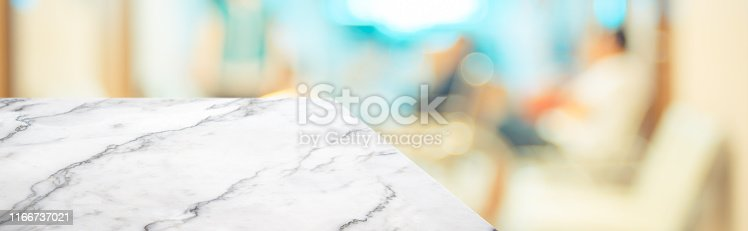 836113142 istock photo marble table top product display background with blur patient in hospital.left perspective stone kitchen counter with people waiting doctor in hallway.Banner mockup presentation for  health product 1166737021