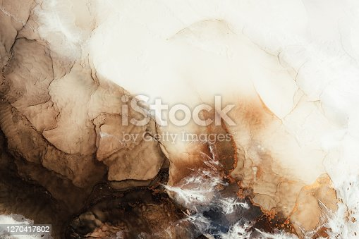 Marble texture art background. Alcohol ink water. White brown beige mineral stone design decor banner. Creative abstract gold metallic fleck sand land streak pattern. Luxury stained surface.