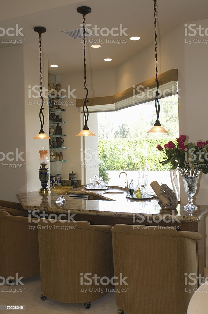 Marble Topped Kitchen Counter With Armchairs stock photo