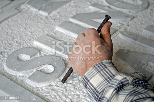 marble worker is making a tombstone.