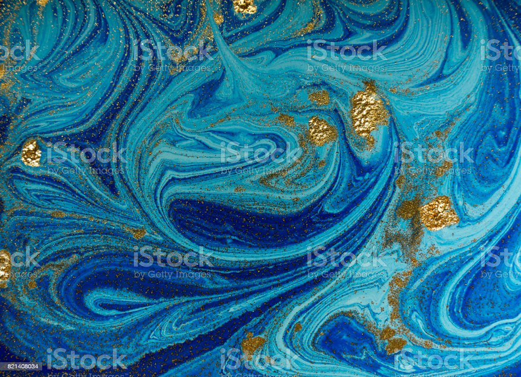 Marbled blue and golden abstract background. Liquid marble pattern stock photo