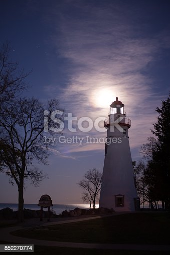 Night Shot of the marblehead lighthouse with the supermoon in the background