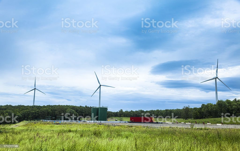 Marcellus Shale Gas Wells and Wind Mills stock photo
