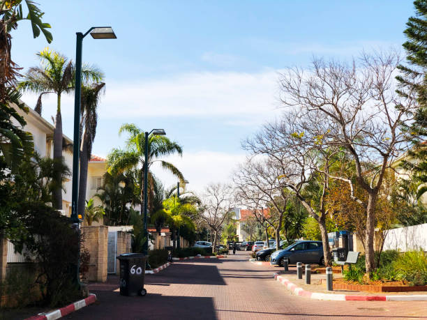 RISHON LE ZION, ISRAEL  March 12, 2019: Private houses, trees and streets in Rishon Le Zion, Israel. stock photo