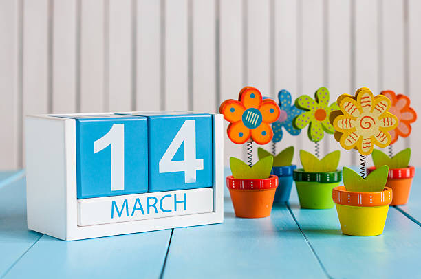 March 14th. Image of march 14 wooden color calendar with stock photo