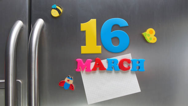 march 16 calendar date made with plastic magnetic letters holding a note of graph paper on door refrigerator - alejomiranda stock pictures, royalty-free photos & images