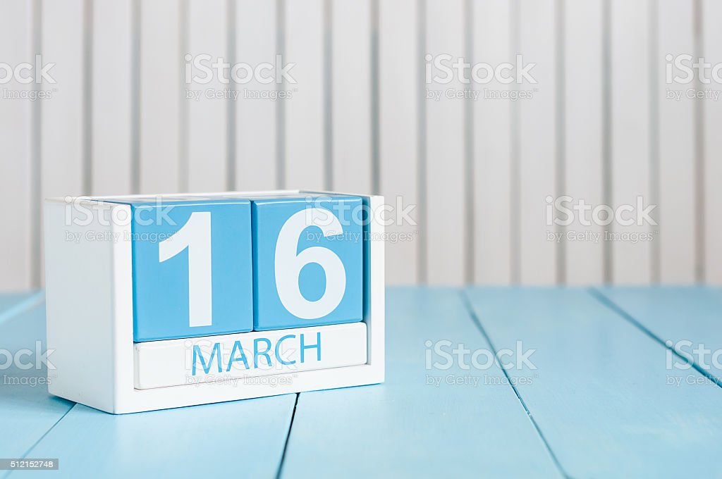 March 16th. Image of march 16 wooden color calendar on stock photo