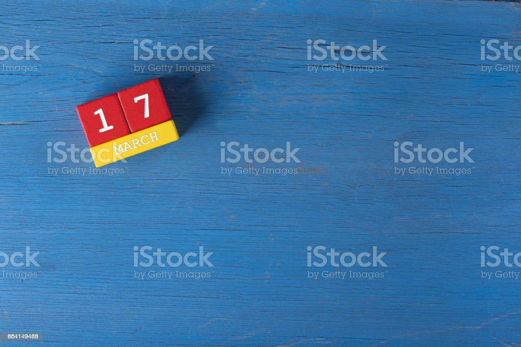 March 17, Cube calendar on wooden surface with copy space royalty-free stock photo