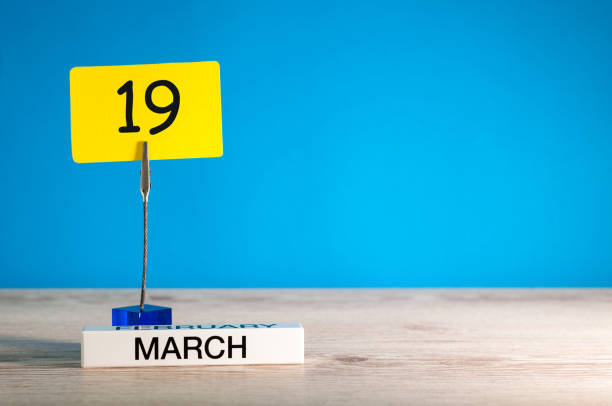 march 19th. day 19 of march month, calendar on little tag at blue background. spring time. empty space for text, mockup - number 19 stock photos and pictures