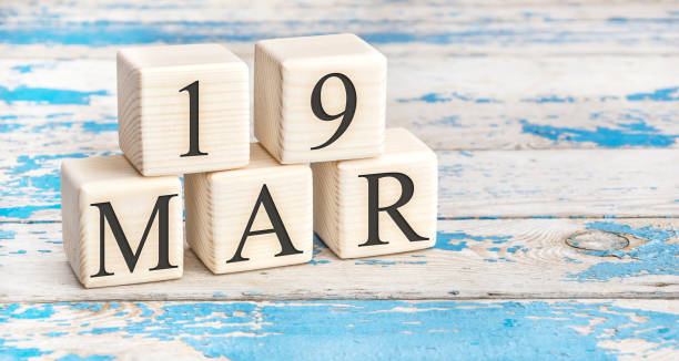 march 19th. wooden cubes with date of 19 march on old blue wooden background. - number 19 stock photos and pictures